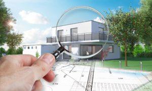 Lupe die auf ein Architektenhaus in Magdeburg zeigt